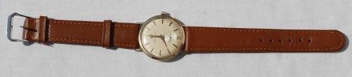 26: 14k gold Jules Jurgensen men's Swiss wrist watch