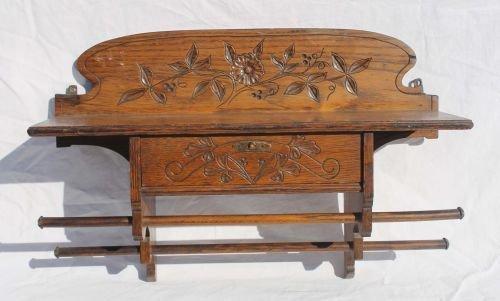 105A: carved oak hanging shelf w floral dec w drawer &