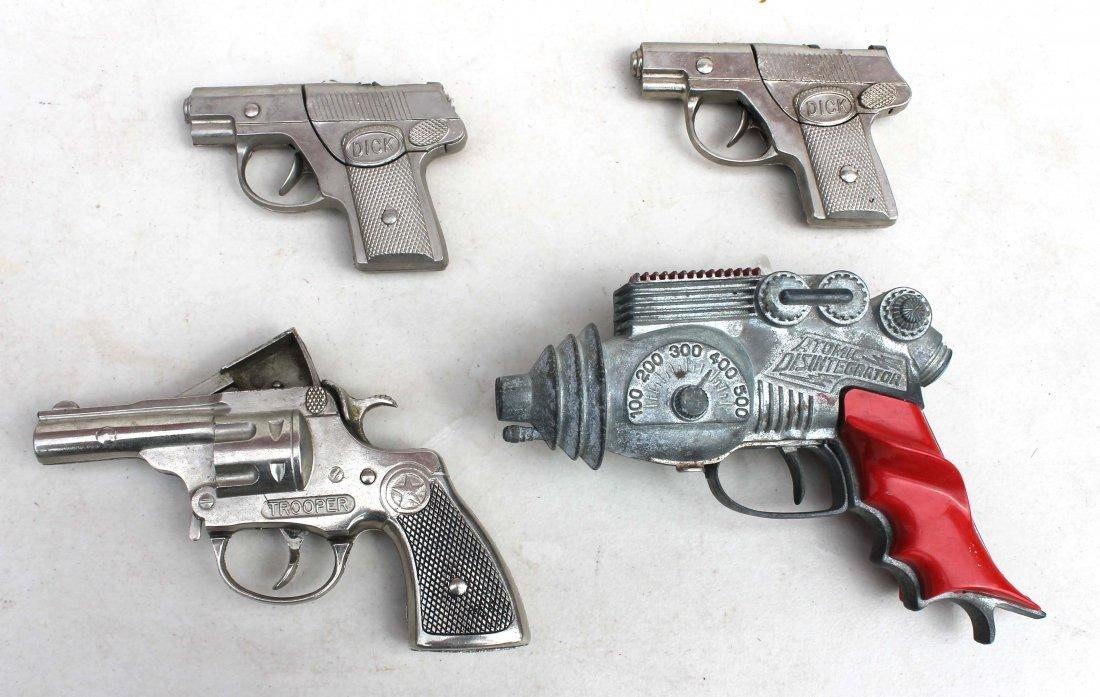 "19: lot of 4 antique toy guns incl 3 cap guns & an ""Ato"