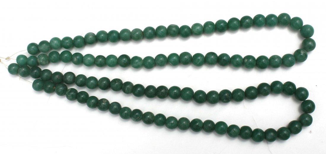 7: 2 Chinese jade strands of beads