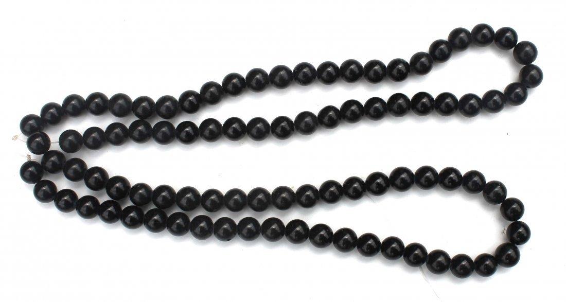 10: 2 Chinese jade strands of beads