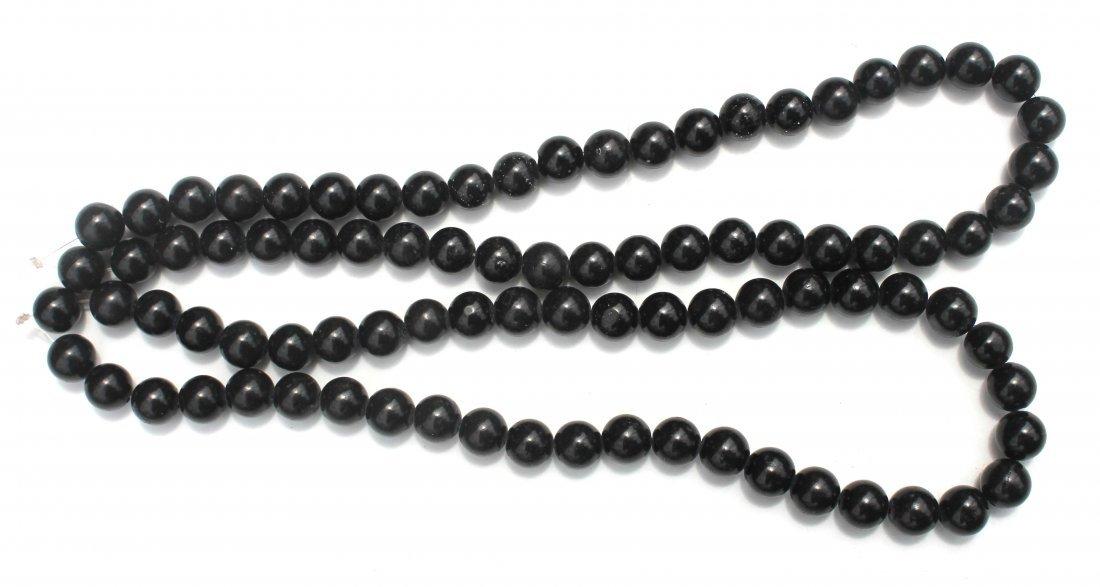 12: 2 Chinese jade strands of beads