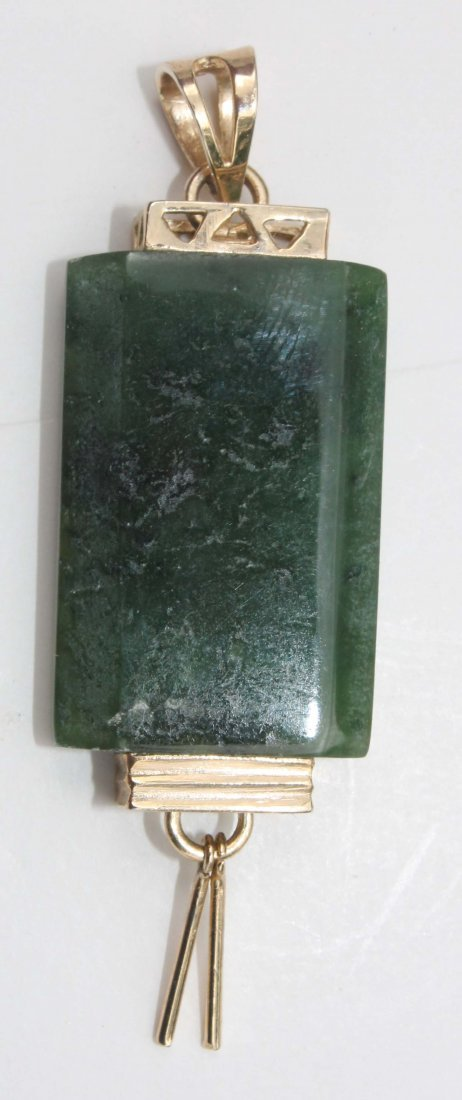 21: Chinese carved jade pendant w vermillion mounts - a