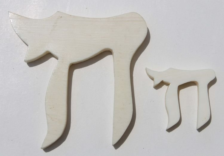 11: 2 Chinese carved ivory characters for jewelry makin