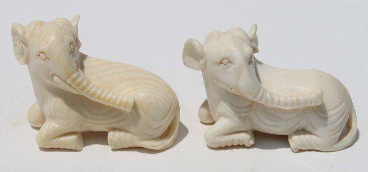 "16: 2 Chinese carved ivory elephants - 1 3/4"" long"