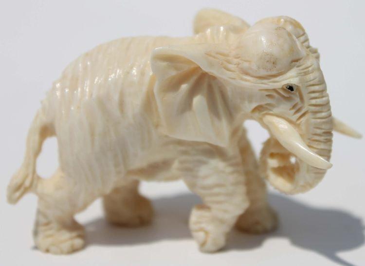 "22: Chinese carved ivory elephant 2 1/4"" long x 1 1/2"""