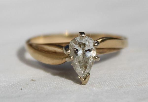 311B: 14k gold & pear shaped diamond engagement ring