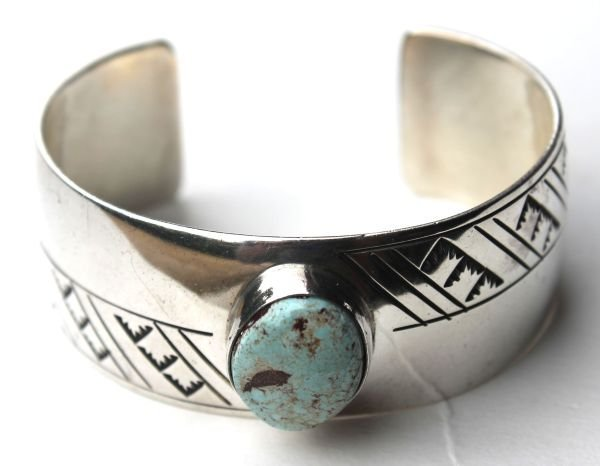 1C: 2 Navajo silver cuff bracelets - 1 featuring dry cr