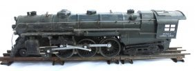 76: antique Lionel locomotive # 763-E on one section of