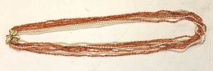 5: Multi strand of Chinese twisted coral & pearl beads