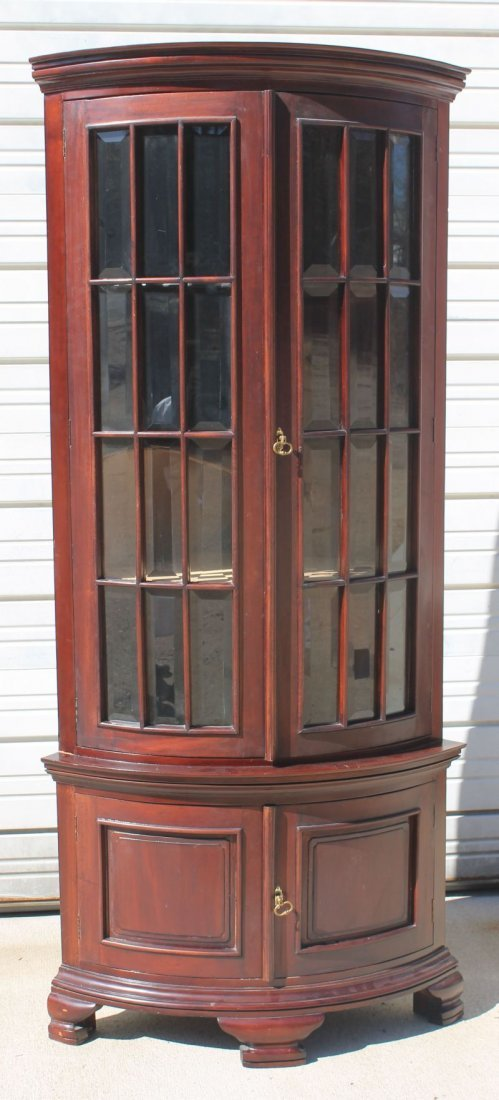 Very stylish rounded mahogany corner cabinet w beveled