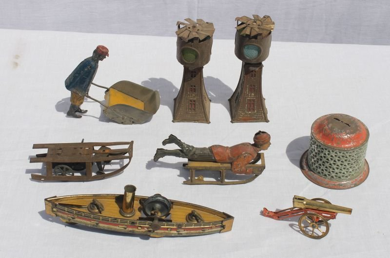 lot of as found antique German toys incl boy on sled,