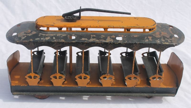 Fine early tin trolley w ratchet wind top in orig paint