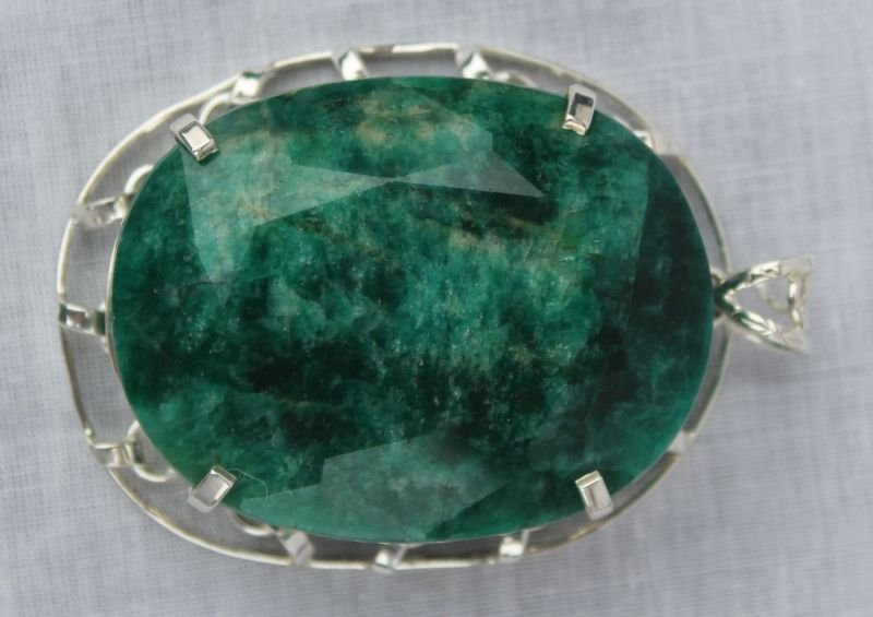 Huge 289.71 ct oval faceted emerald pendant set in