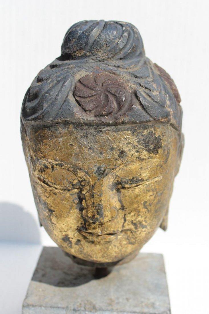 antique carved stone Buddha head on stone plinth w old