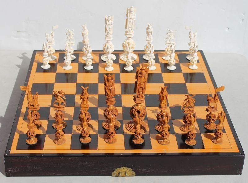 Oriental carved ivory chess set in inlaid gameboard