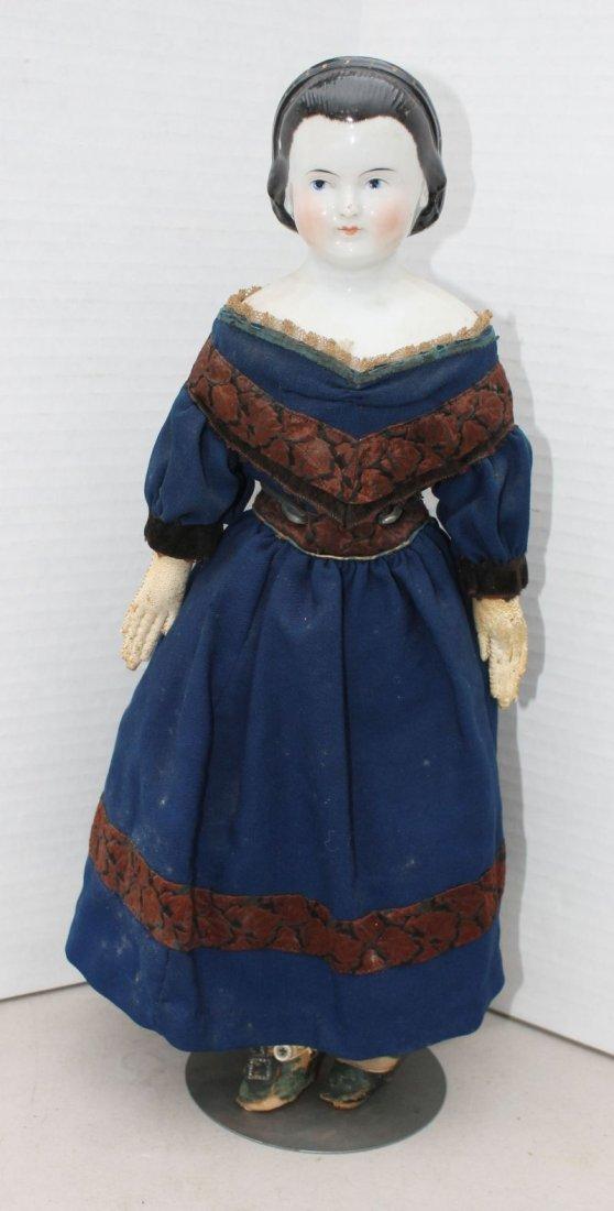 ca 1970's china shoulder head doll on cloth body w