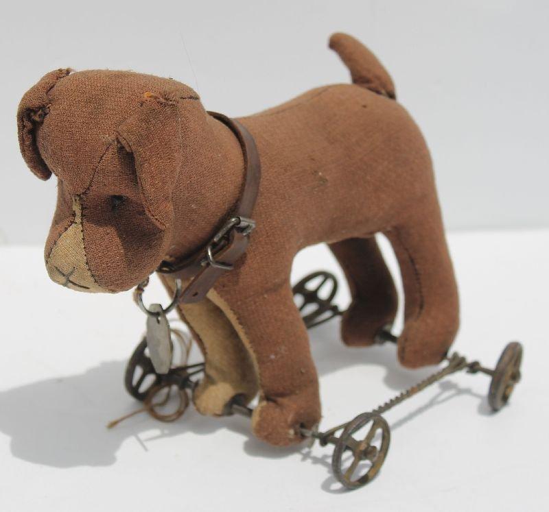 "Rare 19thC 8"" long straw stuffed cloth dog pull toy on"