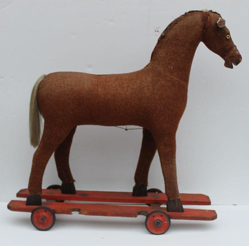 Ca late 19thC mohair covered lg wooden framed horse on