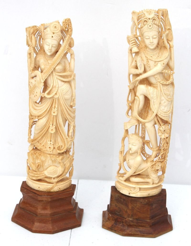 pr of Chinese carved ivory Goddess figures on stands -