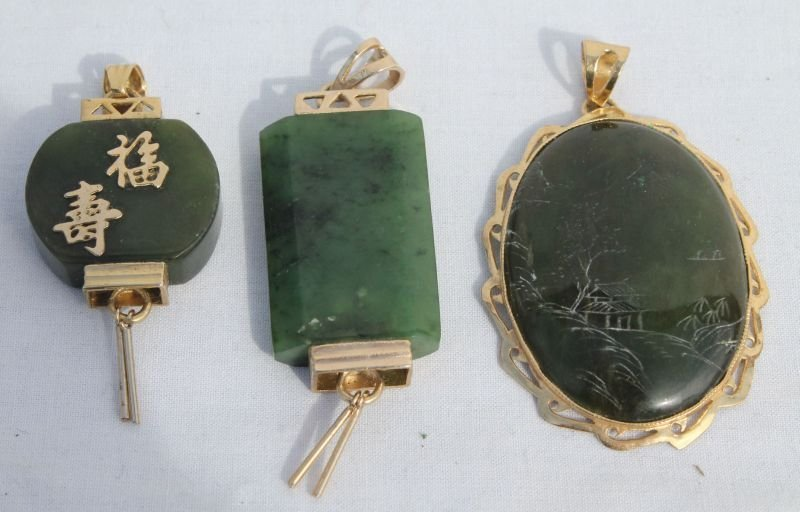 lot of 3 Chinese carved jade & gilt silvered pendants -