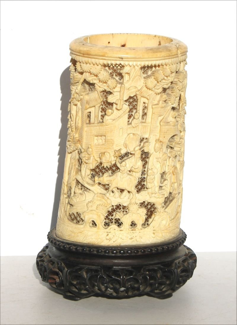 Chinese heavily carved ivory vase on rosewood stand
