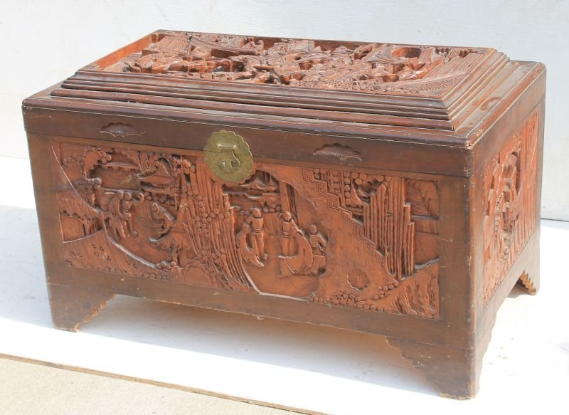 Fine antique Chinese camphorwood carved trunk w battle