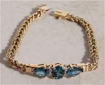 Beautiful 14k gold bracelet w blue topaz & diamonds