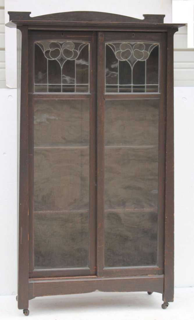 carved oak Art Nouveau leaded glass double sliding door