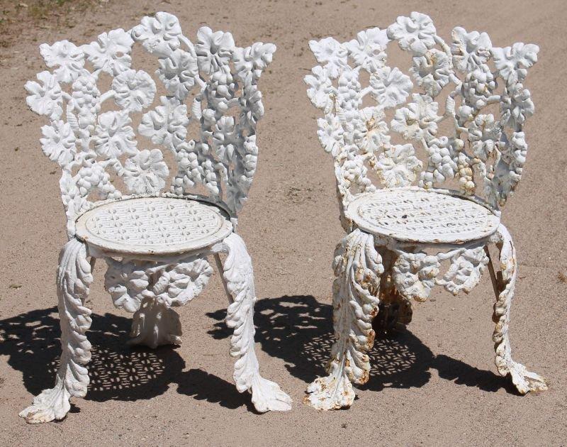 Antique pr of cast iron garden chairs w grape,