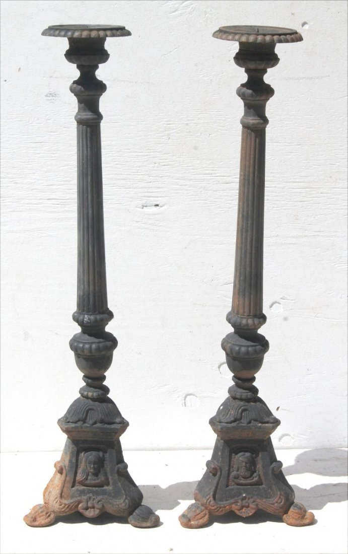 pr of cast iron outdoor used (church) candle stands -
