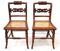 pr of ca 1830s old tiger maple sabre leg sidechairs w