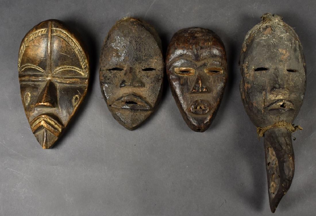 """Four Small Dan """"Passport"""" Masks"""