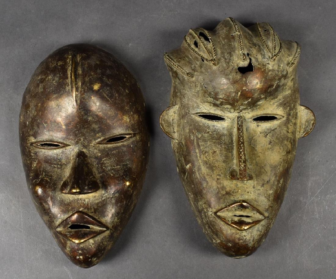 Two Baule Bronze Masks