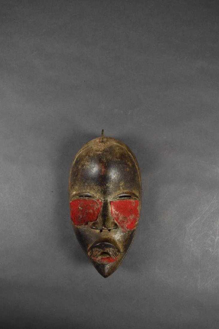 Dan Mask with Red Cloth Details