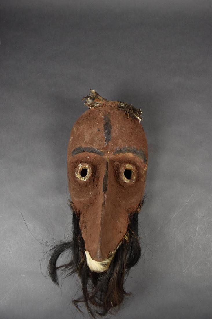 African Mask with Feathers