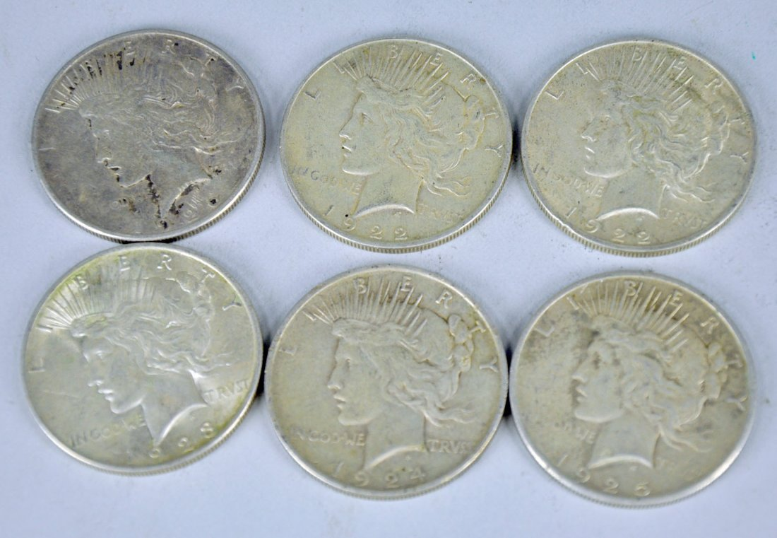 Six Circulated Peace Silver Dollars