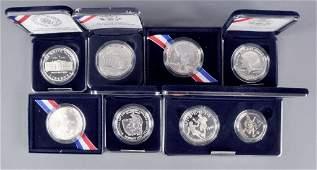 7 Commemorative US Silver Dollars