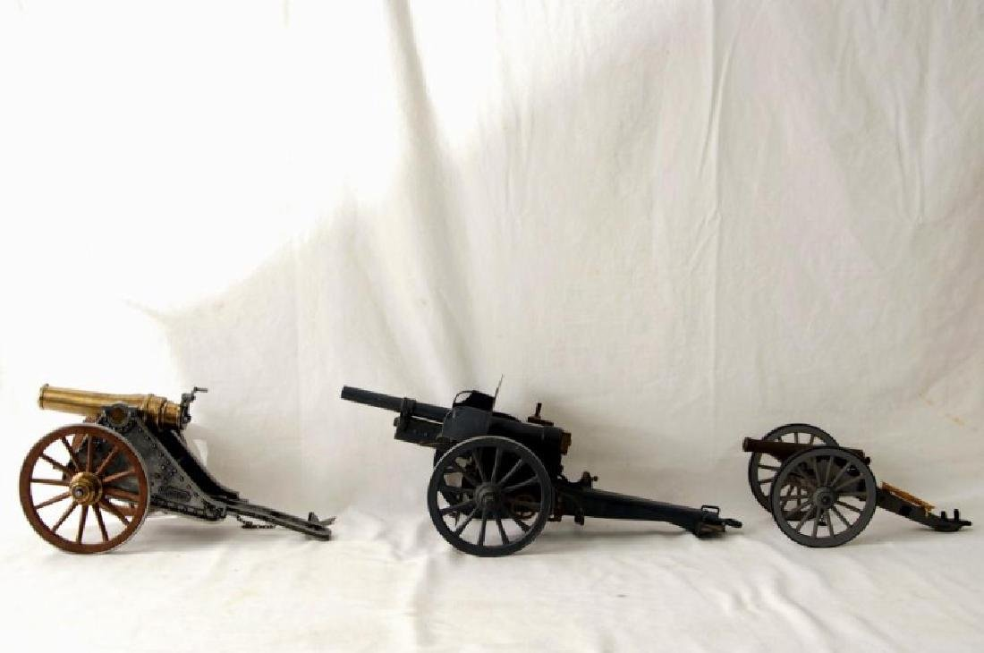 Three small Historic Cannon models