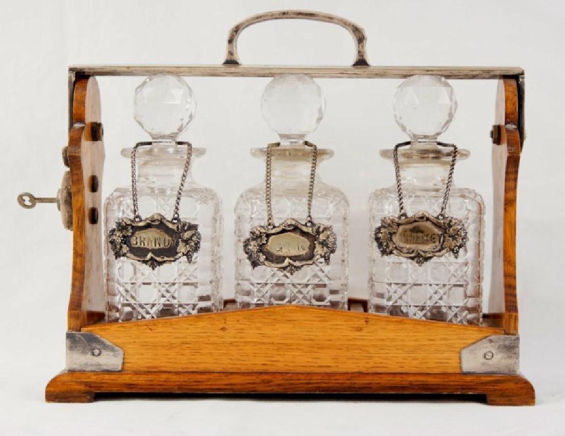 19th cent Tantalus 3 bottle liquor set