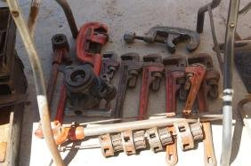 Collection of Ridgid pipe wrenches, dies,