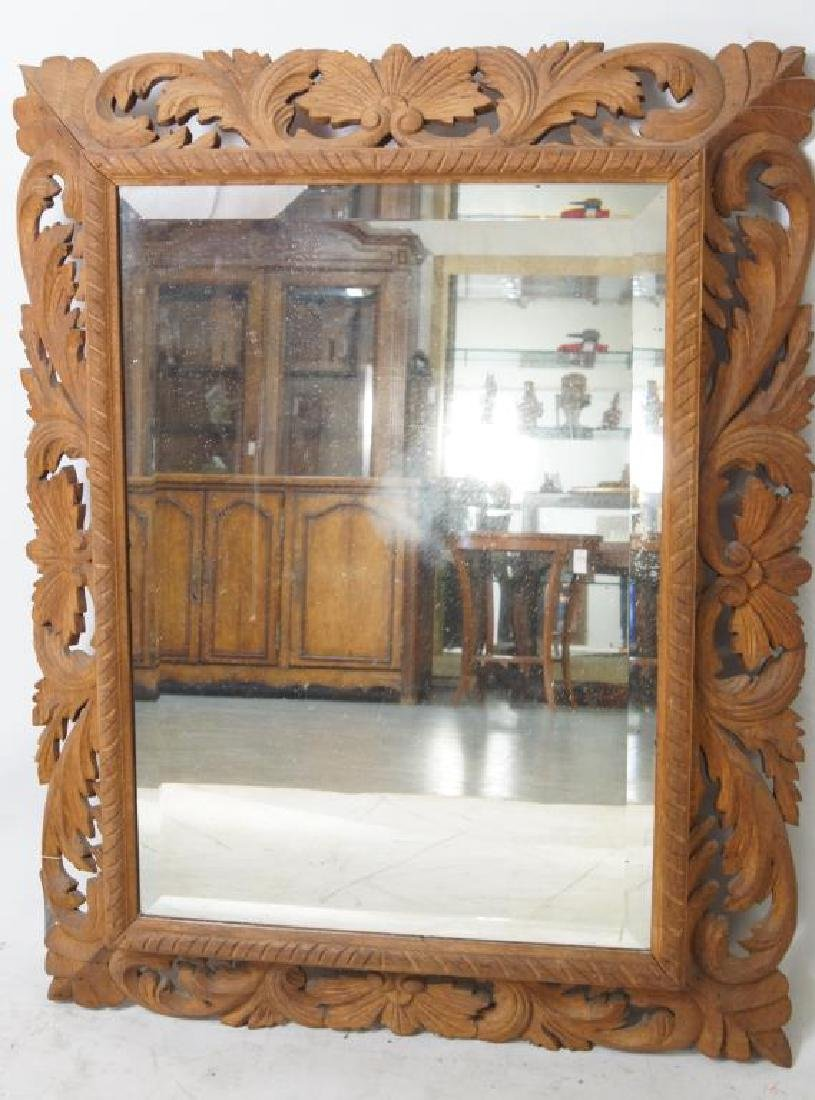 Wood carved beveled mirror