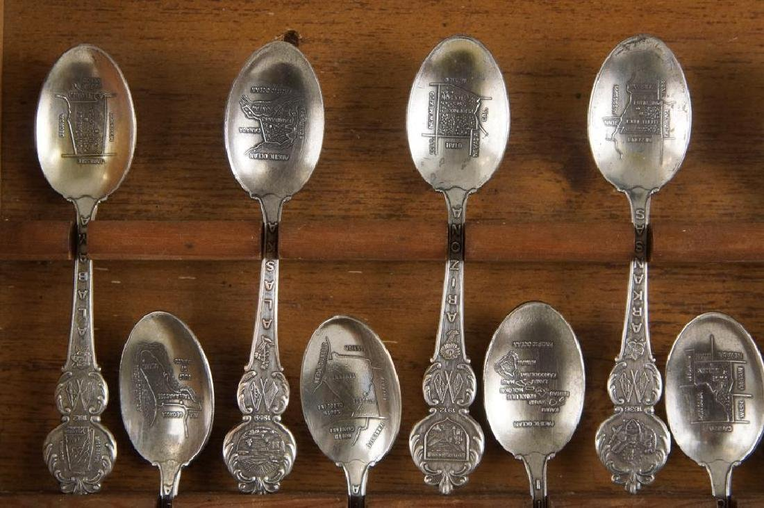 A set of American collectors guild state spoons - 3