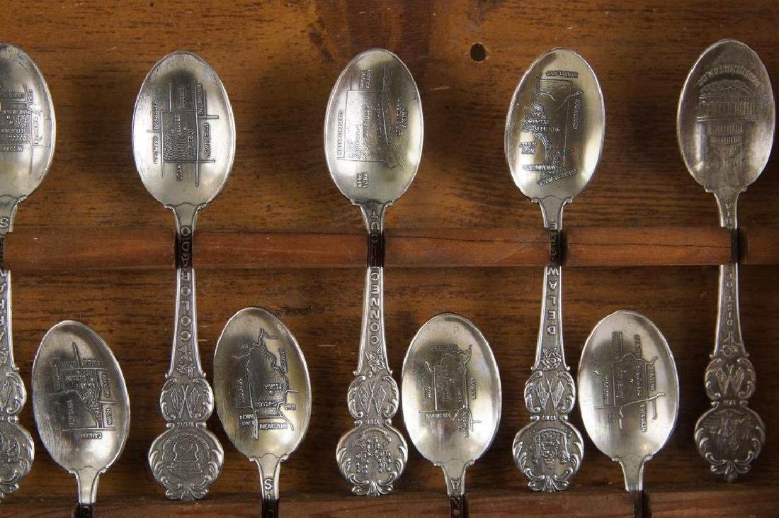 A set of American collectors guild state spoons - 7
