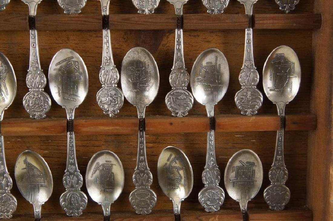 A set of American collectors guild state spoons - 9