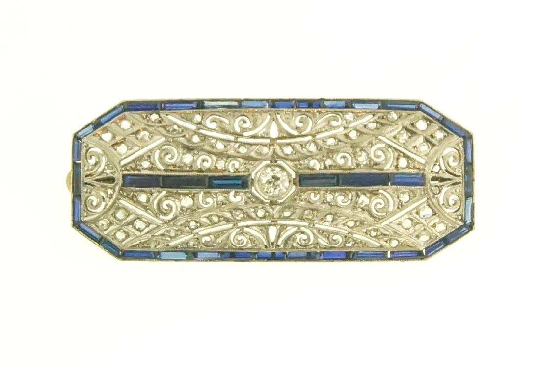 Art Deco 18kt diamond pin w blue sapphire