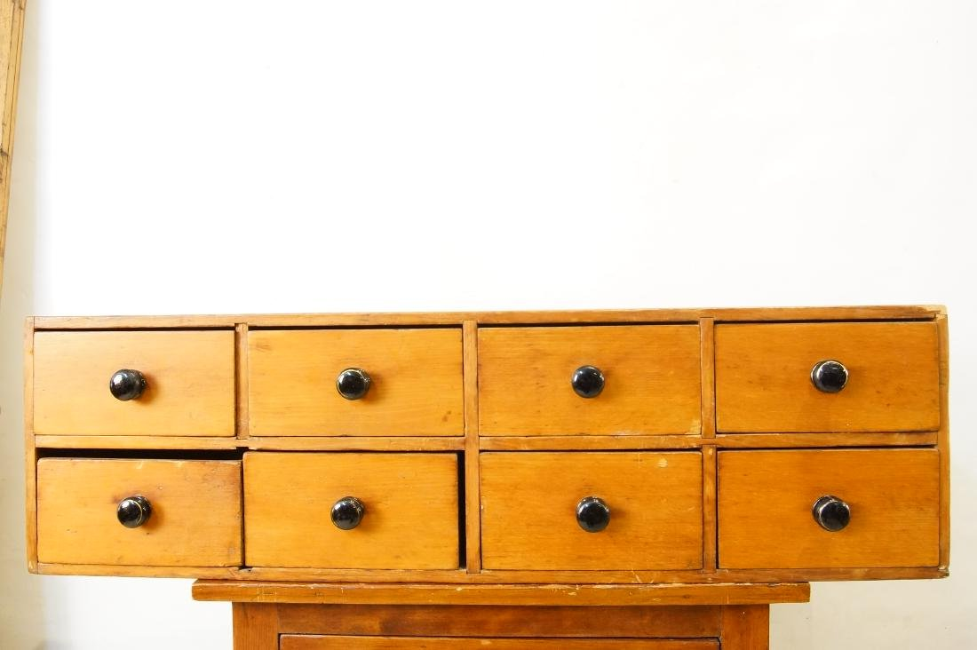 Early American eight drawer cabinet