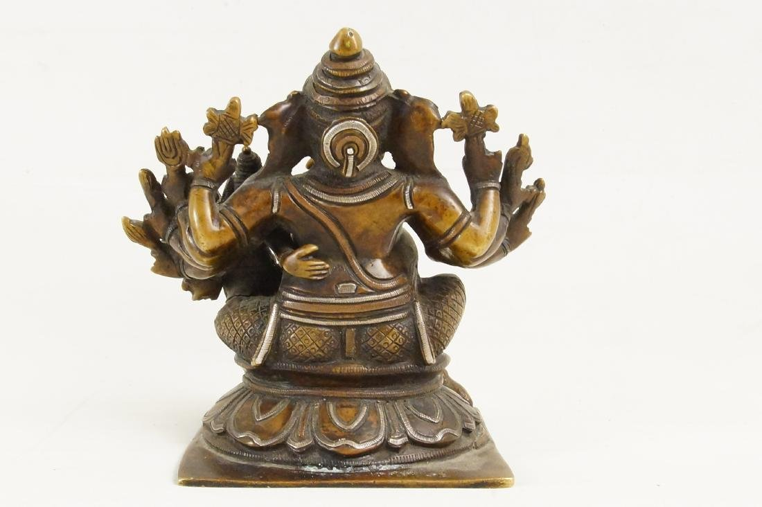 A Rare Indian Bronze Ganesh with Siddhi - 9