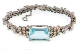 A Fine 18kt gold Aquamarine and diamonds bracelet