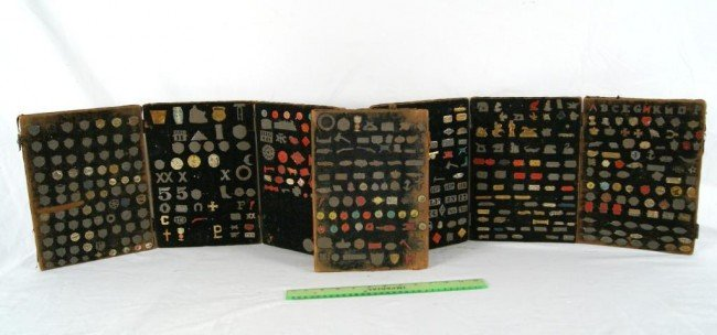 24: Antique Tobacco collection of tin emblems 7 panels